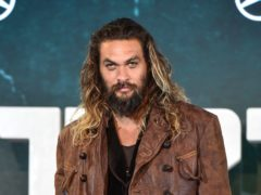 Jason Momoa feeds a bear a biscuit from his mouth in the footage (Matt Crossick/PA)