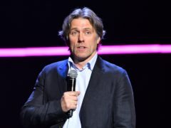 John Bishop said his wife had attempted to pull his piercing out several times (Matt Crossick/PA)