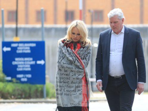 Pamela Anderson leaves Belmarsh Prison accompanied by WikiLeaks editor Kristinn Hrafnsson (Gareth Fuller/PA)