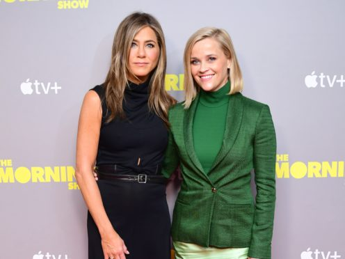 Jennifer Aniston and Reese Witherspoon (Ian West/PA)