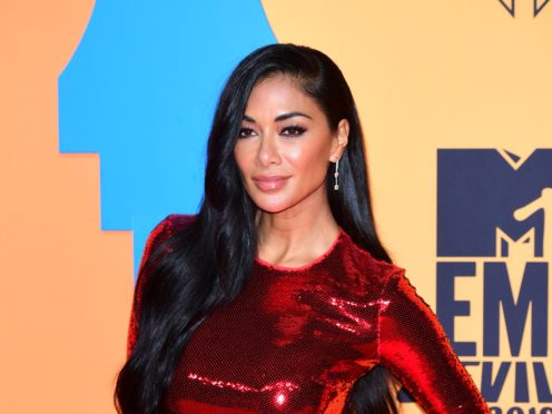 Girl group The Pussycat Dolls are reuniting nine years after their acrimonious break-up, singer Nicole Scherzinger has confirmed (Ian West/PA)