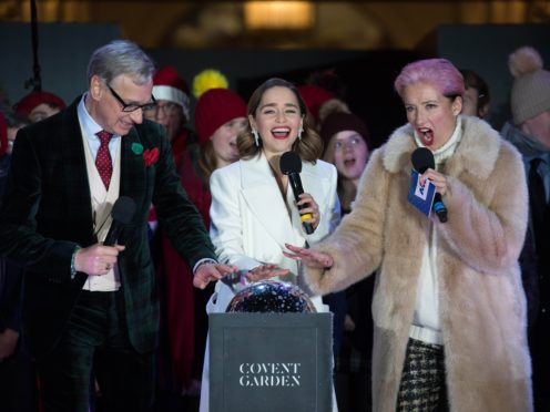 Paul Feig, Emilia Clarke and Dame Emma Thompson switch on the Covent Garden Christmas lights (David Parry/PA)