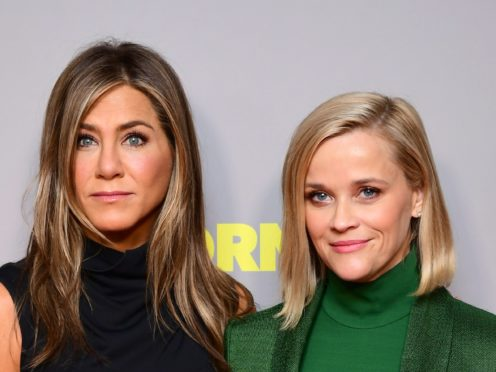 Jennifer Aniston and Reese Witherspoon shared a hug on the final day of filming for The Morning Show (Ian West/PA)