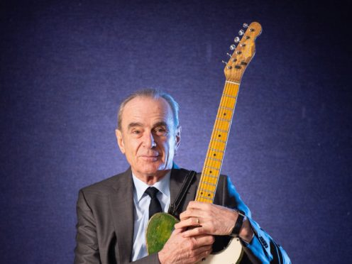 A guitar belonging to Status Quo star Francis Rossi has been sold at auction for nearly £120,000 (Dominic Lipinski/PA)