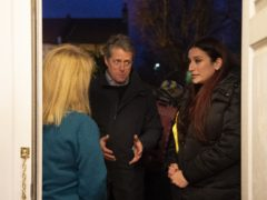 Liberal Democrats candidate for Finchley and Golders Green Luciana Berger, right, and Hugh Grant canvassing in Finchley (David Mirzoeff/PA)