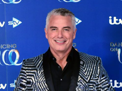 John Barrowman, pictured, is replacing Jason Gardiner on the judging panel on ITV's Dancing On Ice in the new year (Ian West/PA)