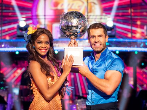 Oti Mabuse and Kelvin Fletcher with the Strictly Come Dancing Glitterball trophy (Guy Levy/BBC)