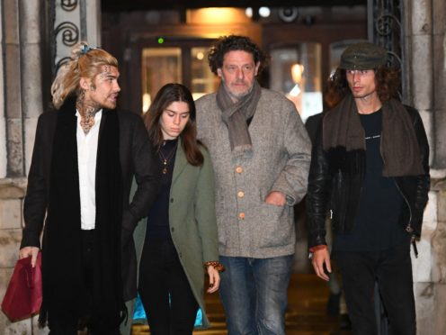 Marco Pierre White, centre right, leaves the Royal Courts of Justice in London accompanied by his children Marco White Jr, left, and Luciano White, right (Victoria Jones/PA)