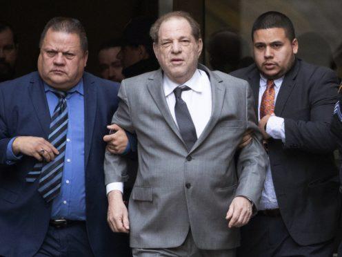 Harvey Weinstein, centre, leaving court following a bail hearing in New York (Mark Lennihan/AP)