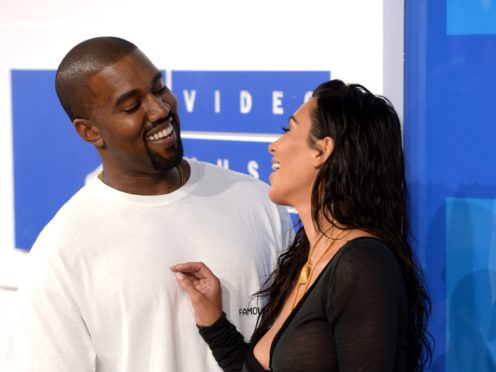 Kim Kardashian and Kanye West (PA)