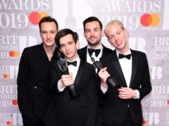 Matthew Healy, Ross MacDonald, George Daniel and Adam Hann of The 1975 with their Brit Awards (Ian West/PA)