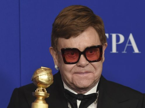 Sir Elton John was among the winners at the Golden Globes for his work on Rocketman (AP Photo/Chris Pizzello)