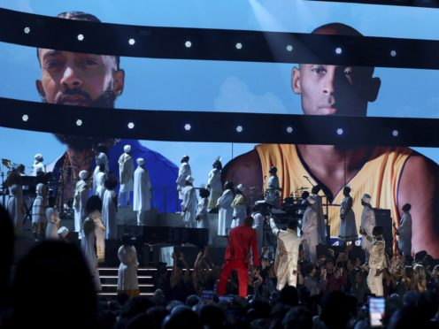 Nipsey Hussle and Kobe Bryant appear on the big screens during a tribute at the 62nd annual Grammy Awards (Matt Sayles/Invision/AP/PA))