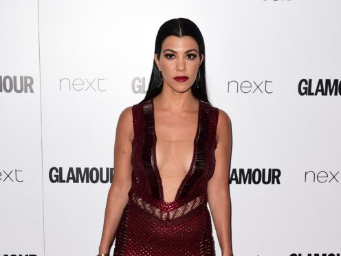 Kim and Kourtney Kardashian appear to come to blows in the latest teaser for the family's reality TV show (Ian West/PA Wire)