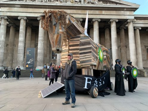 BP or Not BP? activist Phil Ball stands with a Trojan horse that he designed, in front of the British Museum (Isobel Frodsham/PA)