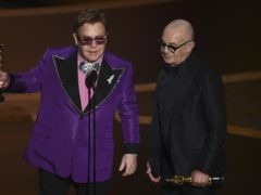 Sir Elton John paid tribute to Bernie Taupin, his song-writing partner of more than five decades, as the jubilant pair were victorious at the Oscars (AP Photo/Chris Pizzello)