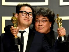 Han Jin-won and Bong Joon-ho with their Oscars for Best Original Screenplay, International Feature Film, Best Director, and Best Picture for Parasite in the press room at the 92nd Academy Awards (Jennifer Graylock/PA)