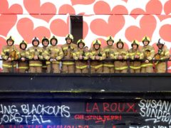 Firefighters gather outside Koko where they were thanked for helping to save the famous London music venue (David Parry/PA)