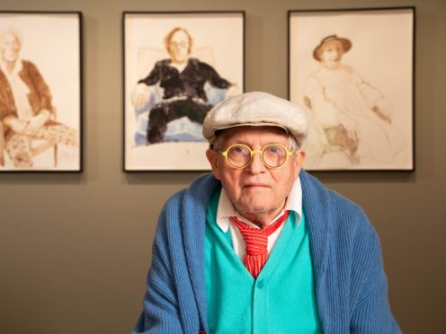 David Hockney with drawings from his exhibition David Hockney: Drawing from Life (David Parry/National Portrait Gallery)