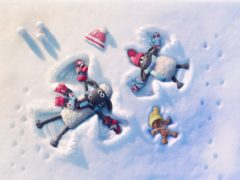 Characters Shaun, Timmy and his teddy making snow angels (Aardman/BBC/PA)