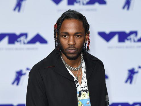 Kendrick Lamar will headline at Glastonbury (PA)