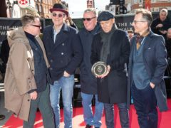 Members of Madness during the unveiling of a stone to honour the band at the Music Walk of Fame in Camden (Aaron Chown/PA)