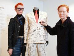 Tilda Swinton signs a suit for the Prospect Cottage campaign 2020 (Matt Alexander/PA)