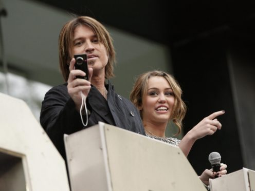 Miley and Billy Ray Cyrus starred alongside each other in Hannah Montana: The Movie (Yui Mok/PA)