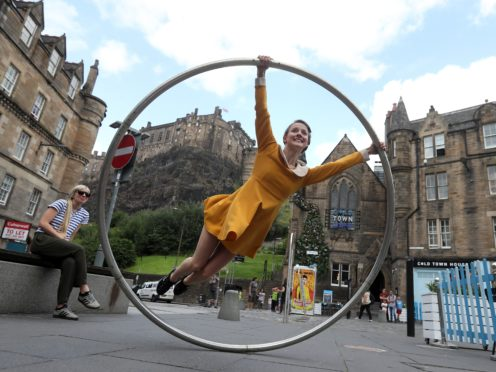 Street performers will not be seen in Edinburgh this summer (Andrew Milligan/PA)