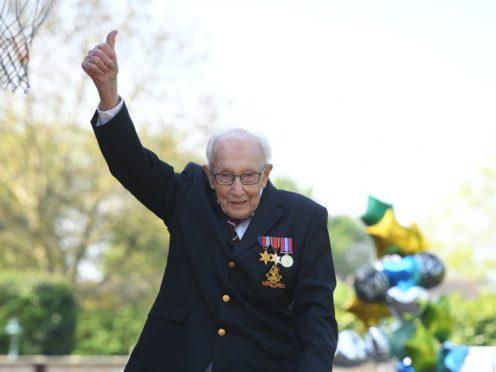 War veteran Captain Tom Moore celebrates the completion of his garden challenge (Joe Giddens/PA)