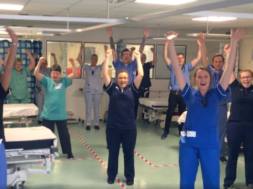 Health workers applauding the nation in the video (ITV)