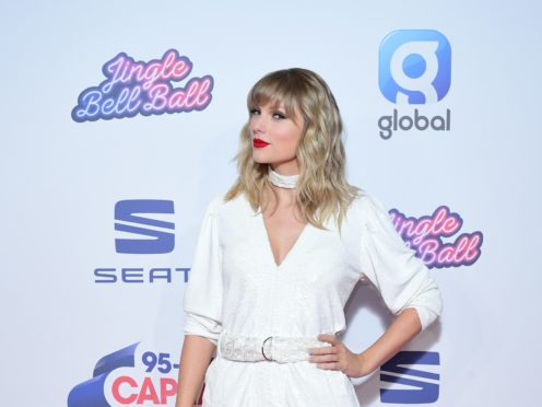 Taylor Swift raised a glass amid isolation, as fans continue to speculate she is planning a major announcement (Ian West/PA)