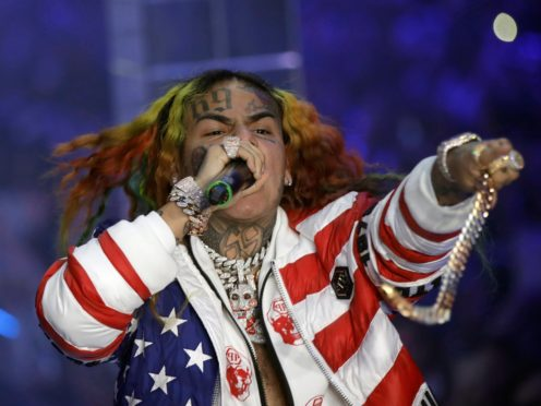Rapper Tekashi 6ix9ine has released his first new song since a judge freed him from prison early over coronavirus fears (AP Photo/Luca Bruno, File)