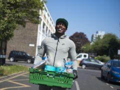 The rapper helped distribute the food parcels at a primary school in Poplar, east London (Ben Stevens/PA)
