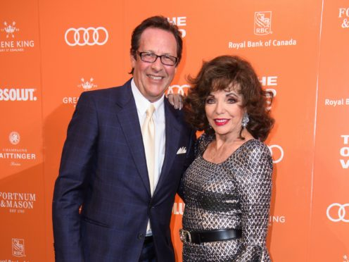 Percy Gibson and Joan Collins are separated by 32 years (Matt Crossick/PA)