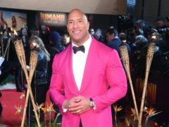 """Hollywood star Dwayne """"The Rock"""" Johnson is teaming up with his ex-wife and a sports management company to buy the XFL American football league (Matt Crossick/PA)"""