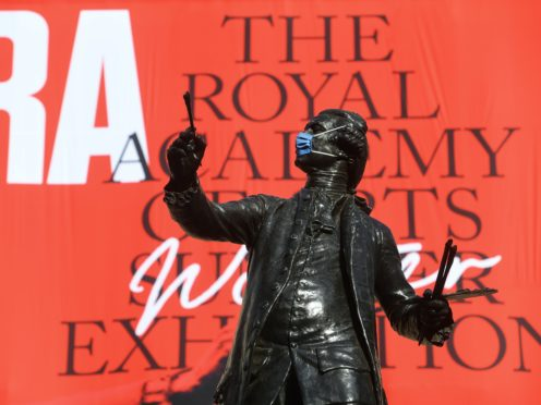 The statue of Sir Joshua Reynolds wearing a mask outside the Royal Academy of Arts in London (Kirsty O'Connor/PA)