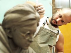 Sculptor Andrzej Szymczyk crafts a life-size dynamic statue of Harry Potter, played by Daniel Radcliffe (Heart of London Business Alliance/PA)