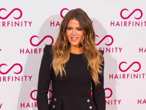 Khloe Kardashian has revealed she was diagnosed with coronavirus earlier this year (Dominic Lipinski/PA)