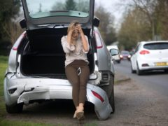 EDITORIAL USE ONLY POSED BY MODELS A road safety experiment to see if members of the public stop to assist stranded drivers when their car is left undriveable after an accident is conducted by Direct Line Motor Insurance on the A246, East Horsley, following the launch if its Onward Travel cover.