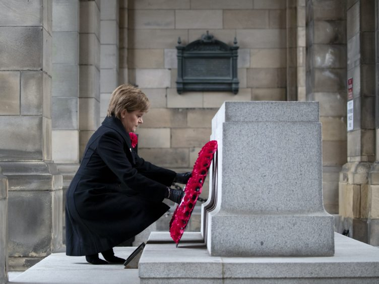 First Minister Nicola Sturgeon will attend a small private service and wreath laying at the Scottish National War Memorial on Remembrance Sunday (Jane Barlow/PA)