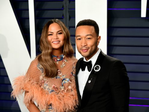Chrissy Teigen has broken her silence following the loss of her baby and told fans she and husband John Legend are 'okay' (Ian West/PA)