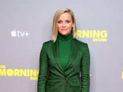 An emotional Reese Witherspoon said the world could do with more people like her character Elle Woods as she hosted a Legally Blonde reunion (Ian West/PA)