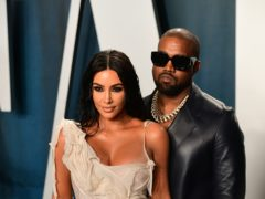 Kanye West shared a throwback picture to the night he popped the question to Kim Kardashian West as he wished his wife a happy 40th birthday (Ian West/PA)