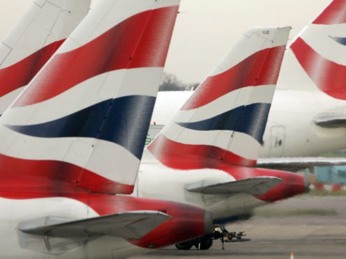 British Airways' parent company IAG has announced its flight capacity between October and December will be 'no more than 30%' of what it was during the same period in 2019 (Tim Ockenden/PA)