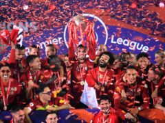 Liverpool captain Jordan Henderson (centre) lifts the Premier League trophy (Laurence Griffiths/PA)