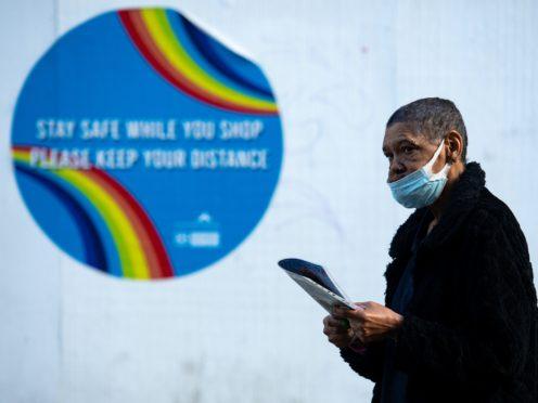 A man walks through Nottingham city centre wearing a face mask (Jacob King/PA)