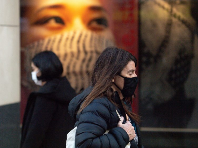People wearing face coverings in Nottingham city centre (Jacob King/PA)