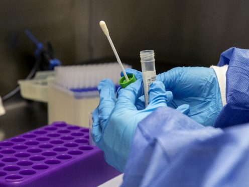 A medical laboratory assistant prepares Covid-19 tests (Peter Byrne/PA)