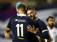 Finn Russell, right, celebrates with Duhan van der Merwe after setting up his debut try (Jane Barlow/PA)
